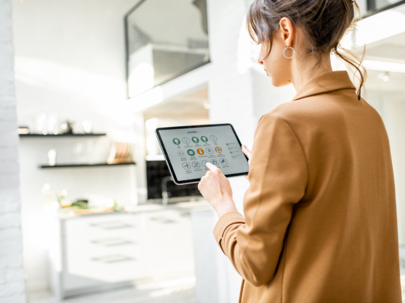 A woman controls her smart home